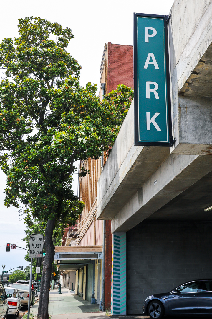 Sign over parking garage entrance that says, 'Park' in Downtown Stockton.